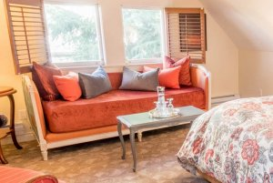 coral sofa with throw pillows