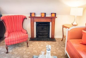 wingback chair and fireplace