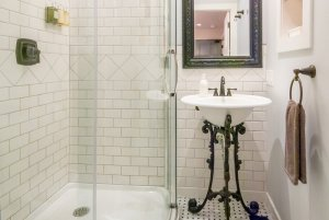 standing shower and ornate sink