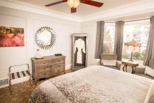 bedroom with window and bathrobe closet