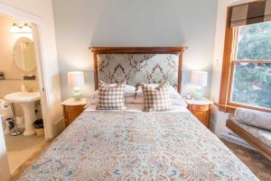 ornate bed with headboard and bedside lamps