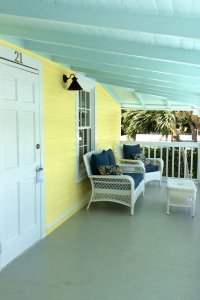 exterior porch with white wicker chairs