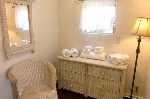 wicker furniture and towels