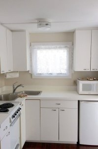kitchen stove, sink, and cabinents