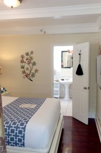 bed floral wall decoration with view into bathroom
