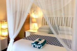 bed with canopy and rolled towels
