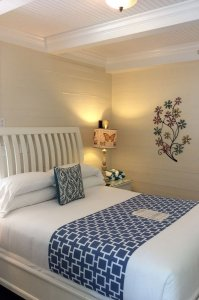 bed nightstand with lamp floral wall decoration