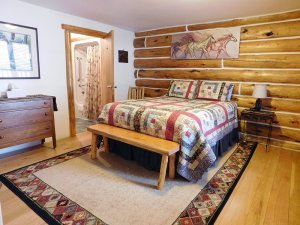 log cabin wall with bed