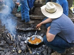 man cooking over a fire