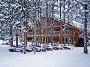 snowmobiles in front of lodge