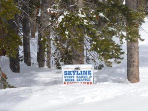 skyline guest ranch sign in the snow