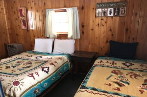 Two beds with kokopelli bedspreads