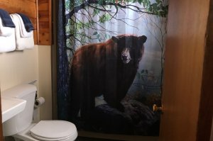 bathroom with bear shower curtain
