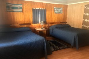 Two double beds with blue spreads
