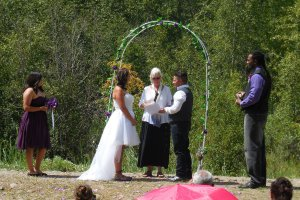 Wedding ceremony under outdoor archway