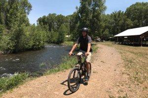 Man on a bike near river