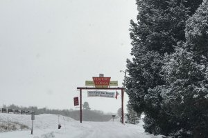 Elkhorn Lodge Sign in the snow