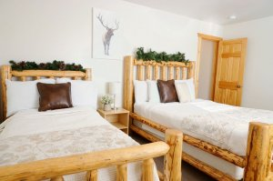 Two beds and elk art