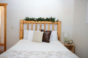Bed with Leafy Headboard