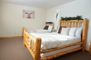 Two Beds with Leafy Headboard