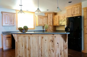 Kitchen with island and wood cabinet