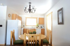 Dining Room Table with seating for four and kitchen