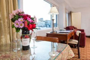 Flowers and wine with anchorage window view