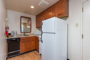 Kitchen area with fridge