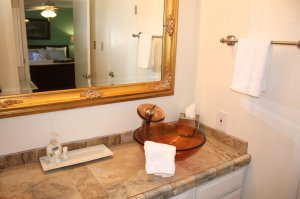 bathroom sink and tile counter