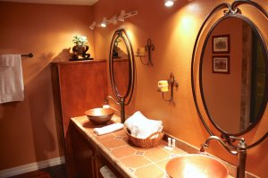 bathroom with track lighting and wash basins