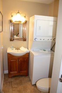 bathroom with laundry machines