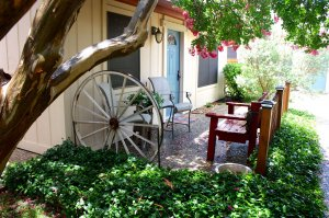 patio with wagon wheel and seating