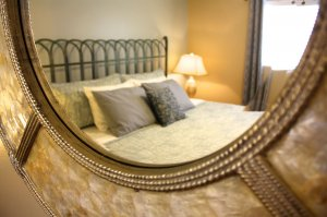 bed cushions in ornate mirror