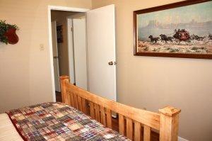 bedroom with western art