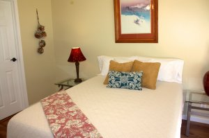 twin bed and bedside lamp