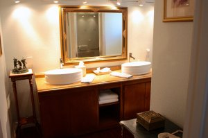 bathroom with wash basins and mirror