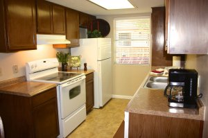 kitchen with oven and wood cabinets