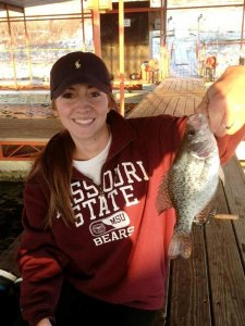 Girl holding small mouth bass