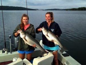 2 Girls holding Stripped Bass
