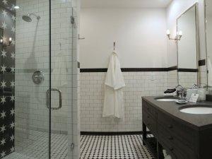 Bathroom with Stand in shower, two sinks, and bathrobe