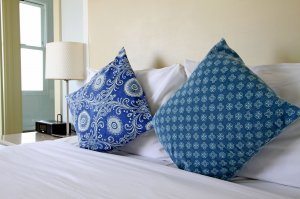blue throw pillows on bed