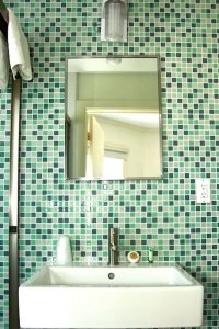 bathroom sink and tile wall