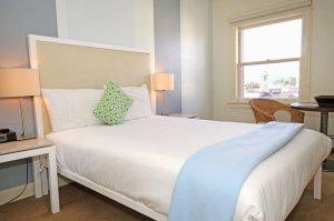 Bed beside open window