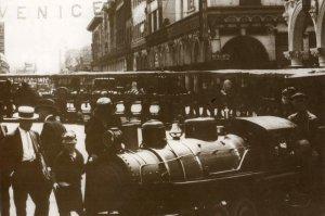 men standing beside steam locomotive