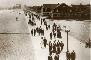 old fashioned men and women on ocean boardwalk