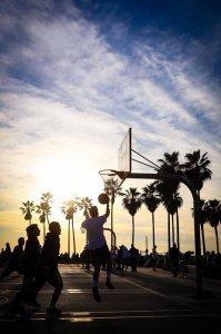 playing basketball beneath palm trees