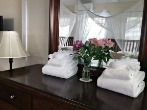 dresser with mirror and towels