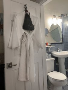 bathrobe hanging on bathroom door