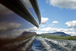 The Side of a Boat on a Lake