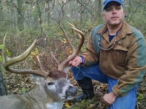 Hunter with his harvested buck